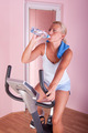 Woman on exercise bike - PhotoDune Item for Sale