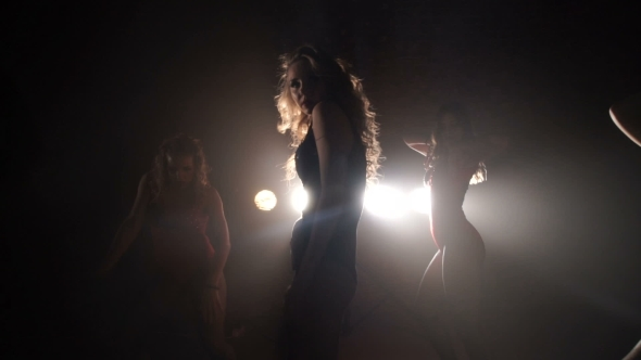 VideoHive Five Girls Dancing In Studio On a Background Of Spotlights Silhouettes 16700767