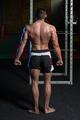 Handsome Bodybuilder Making Side Triceps Pose