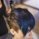 The Girl With Blue Hair In a Beauty Salon.