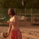 Pretty Man Playing Volleyball On The Beach