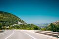 Beautiful asphalt road, freeway, motorway, highway under sunny b