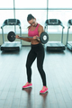 Fitness Woman Doing Exercise For Biceps With Barbell