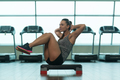 Fitness Woman Doing Abdominal Exercise On Stepper