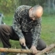 Man Sawing a Small Branch