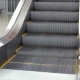 Empty Escalator Stairs Moving Up In Modern Office Building