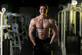 Fitness Man Doing Exercise With Dumbbells Shoulders