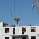 A Construction Crane Delivers Cement For Builders