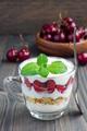 Cherry, muesli and yogurt dessert in glass cup, cherry verrine
