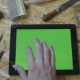 Male Hand Of Artisan Craftsman Using Tablet Pc With Green Screen In Workshop.