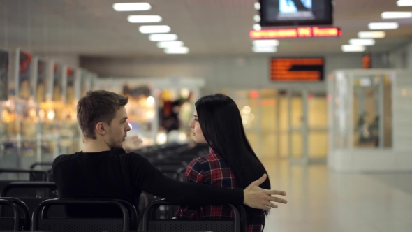 Download Couple Of People Actively Talks With Each Other Sitting In Airport nulled download
