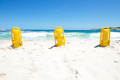 Three yellow life saving buoys on beach