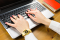 Close-up of typing female hands on keyboard