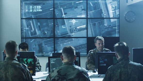 Download Group of Military IT Professionals on Briefing in Monitoring Room Filled with Displays on Military B nulled download