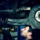 Mechanic Renew Brake System Of a Vehicle On a Car Lift