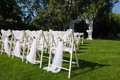 White decorated chairs on a green lawn