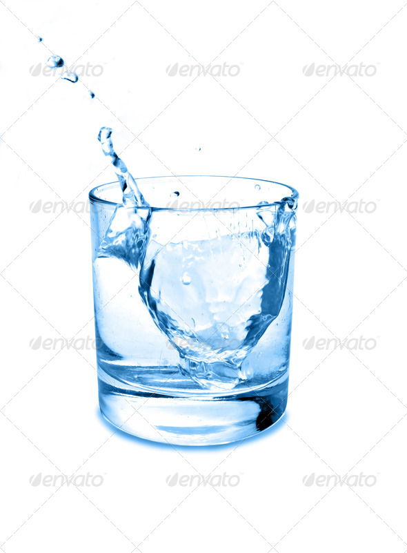 Glass of water with drops - Stock Photo - Images