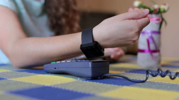 Download Girl Was Paying Using a Smart Watch in a Cafe nulled download