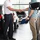 Car selling in showroom