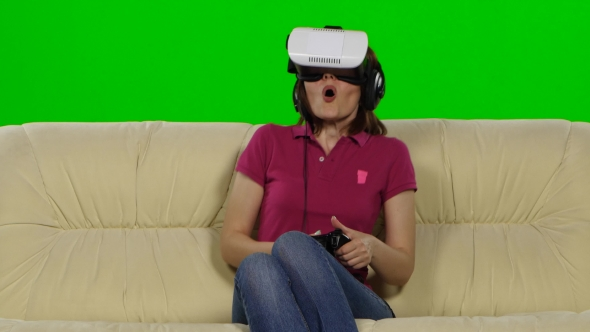 Download Woman In Virtual Reality Glasses On The Couch. Green Screen.  nulled download