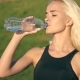 Sporty Woman Drinking Water Outdoor On Sunny Day On Sunset