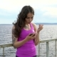 Fitness Girl On The Embankment Of The River. Relax Listening To Music.