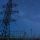 Power Transmission Line Tower On a Starry Sky.