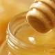 Honey And Honey Combs In Glass Jar And Dipper