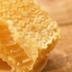 Sweet Honeycomb And Wooden Spoon