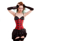 Sexy alternative model in red corset on white background
