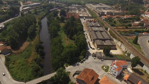 VideoHive Flying Over Abandoned Factory Near River and Railway 17017389