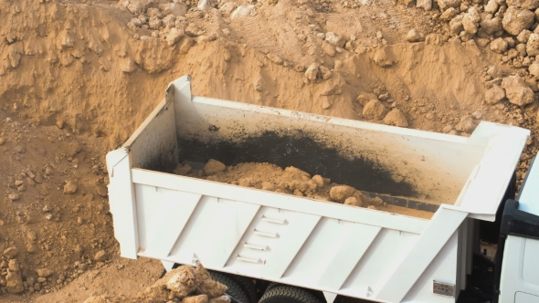 VideoHive Dump Truck Being Loaded With Soil By Shovel 17018546