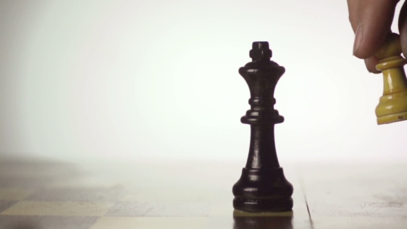 VideoHive White Chess Player Knocks Down The Black King With His Piece 17018547