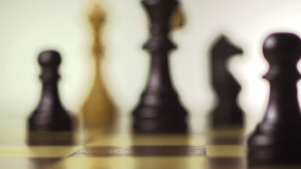 VideoHive White Chess Player Knocks Down The Black King With His Piece 17018558