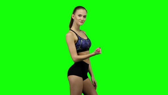 Download Woman Is Engaged With Weights In One Hand. Green Screen nulled download