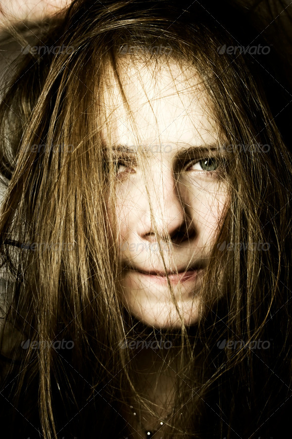 Portrait of the young woman with long hair - Stock Photo - Images