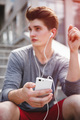 Athlete taking rest with smartphone after urban running