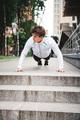 Athlete doing pushups before running