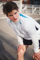 Athlete taking rest after urban running