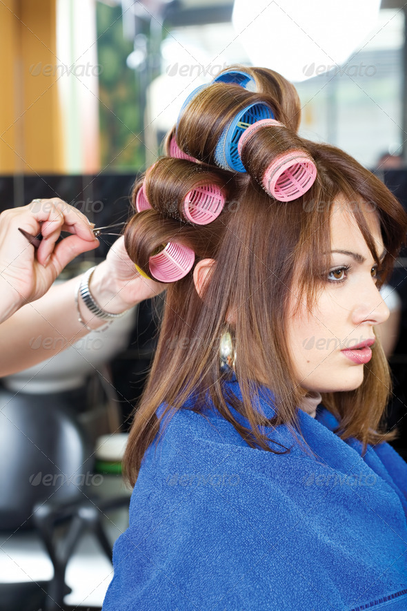 pinching client's curlers - Stock Photo - Images