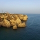 Ponta Da Piedade Lighthouse On Cliff Near Ocean At Sunset, Lagos, Aerial View