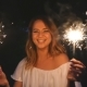 Happy Young Woman With Sparklers