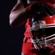American Football Player Showing Helmet