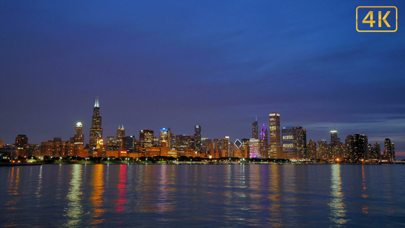 Download Chicago Skyline Reflected on the Lake at Sunset nulled download
