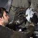 Man Repair Automobile Brake System.