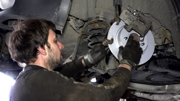 VideoHive Man Repair Automobile Brake System 17125721