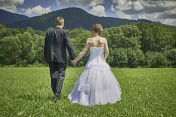 Newlyweds in a meadow