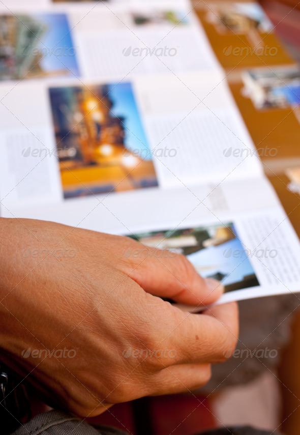 PhotoDune Woman reading a brochure 1707061