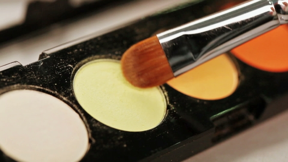 Download Makeup Brush Moving Over Multicolor Eye Shadows Palette nulled download
