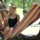 Young Lady Relaxing On Hammock On a Beach